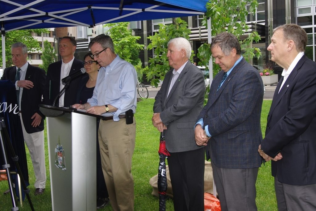 Mayor Jim Watson (speaking) with other event speakers.