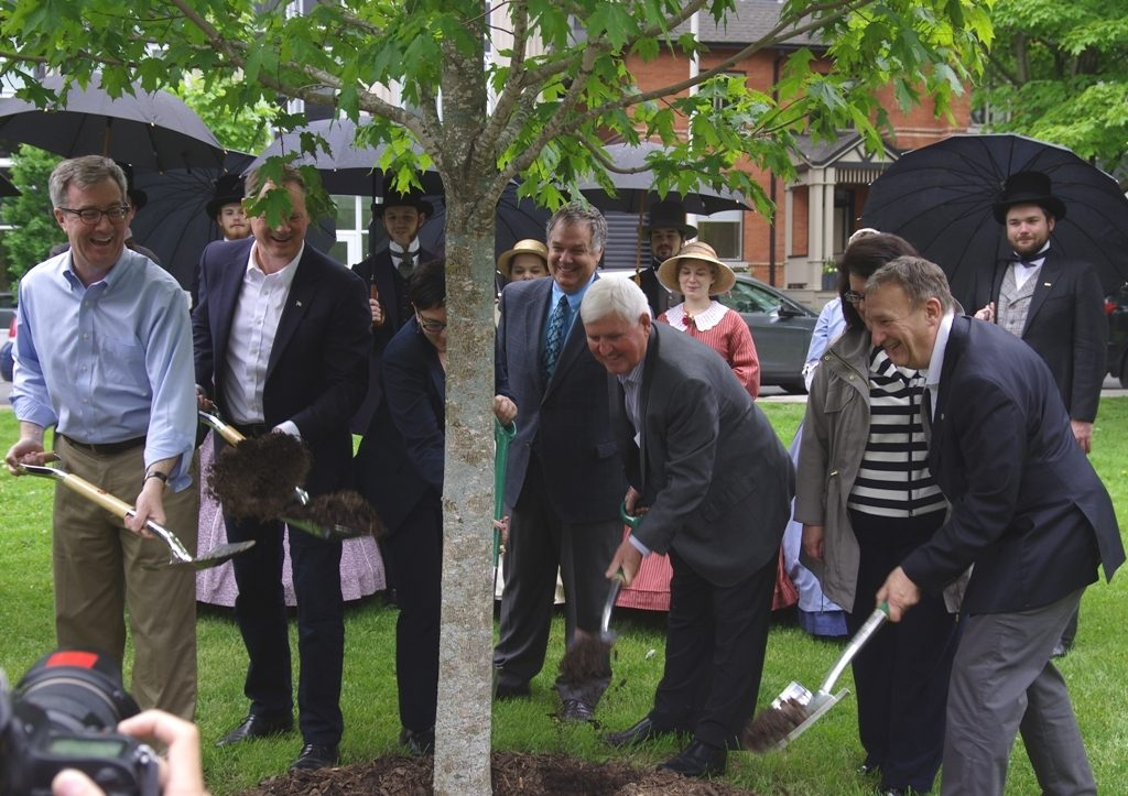 "Mayor Jim Watson (left) and event speakers ""tossing some dirt""."